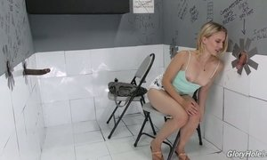 Blond bitch Riley Reyes is sucking a huge black penis in the glory hole room