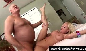 Teen fingers herself while licking nutts