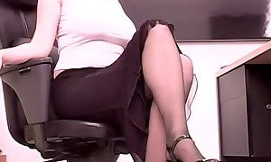 Busty brunette secretary plays with a big dildo at her desk